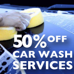 50% Car Wash - hand holding sponge on car